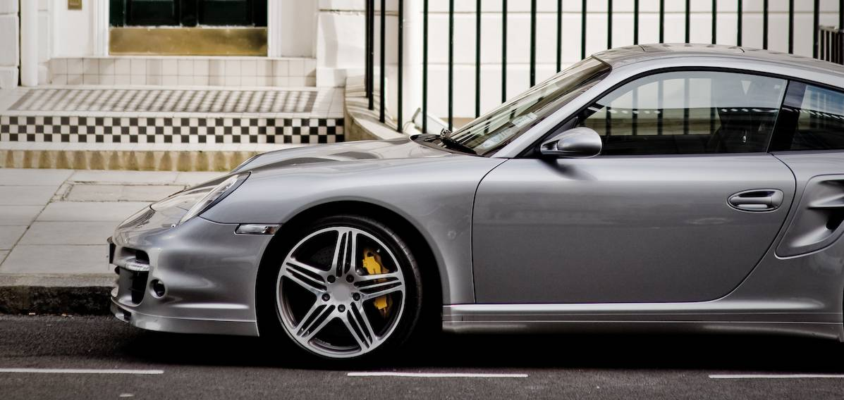exotic car financing for porsche parked on street